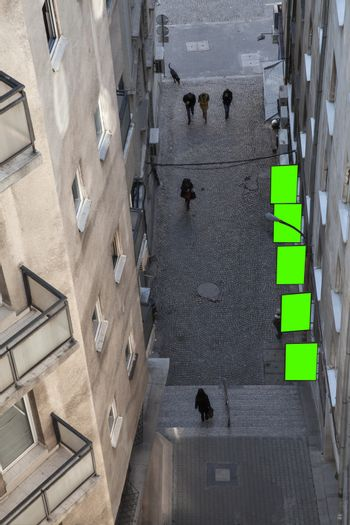 A tiny alley with billboards executed in green from above.