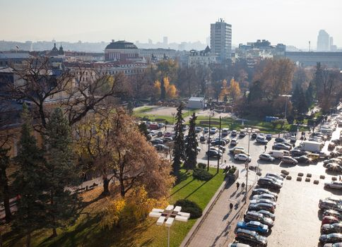 A panoramic view of sofia downtown with yellow pavement and garden infront of the National theatre.