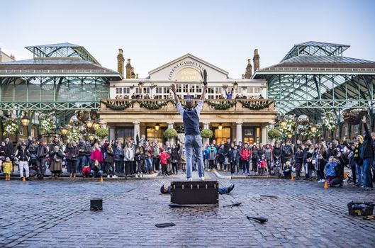 LONDON, UK - DECEMBER 29: Covent Garden market, one of the main tourist attractions in London, known as restaurants, pubs, market stalls, shops and public entertaining. On December 29, 2017