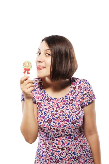 girl in pink with lollipop