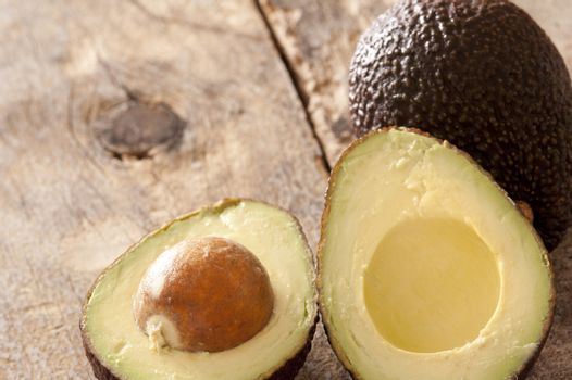 Fresh cut avocados on table