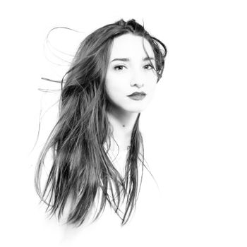 black and white high key portait of a girl with long windy hair