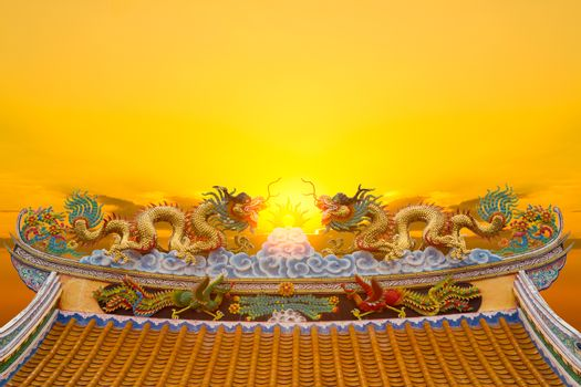 Dragon statue with sun light background.