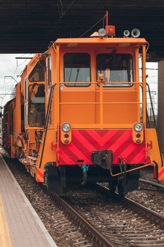 Ballast distributing and profiling track machine. Repair train