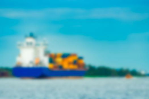 Cargo ship - soft lens bokeh image. Defocused background