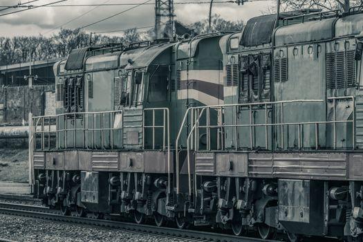 Old diesel cargo locomotive. Freight train in action