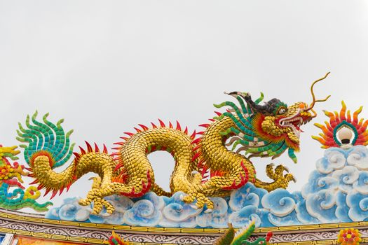 Dragon statue with gray sky background.