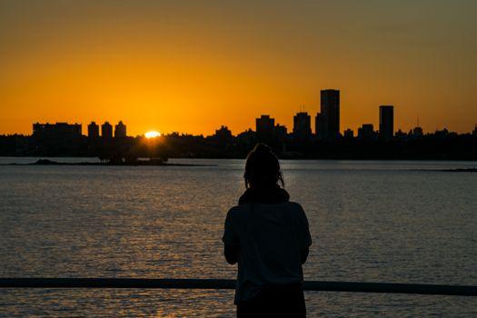 Silhouette sunset cityscape scene from plaza virgilio square in Montevideo city, Uruguay