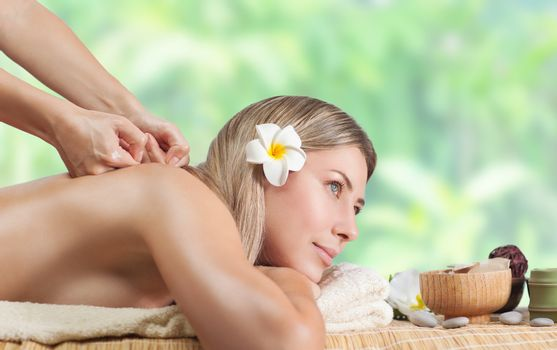 Peaceful female enjoying massage on the beach, spa salon, dayspa on the tropical resort, pampering and beauty treatment concept