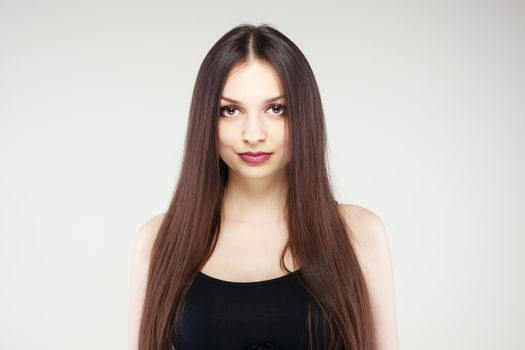 portrait of young girl with long brunette hair