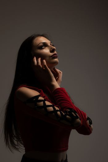gothic style girl in red shirt, looking up
