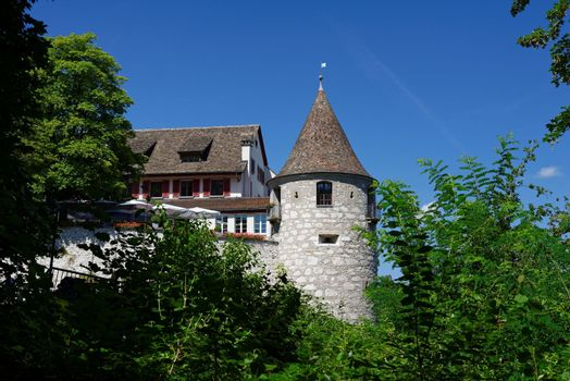 Tower and roof of Medieval Laufen castle in Switzerland