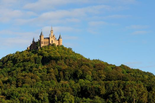 Majestic Hohenzollern Castle on top of Mount Hohenzollern at sunset, Germany