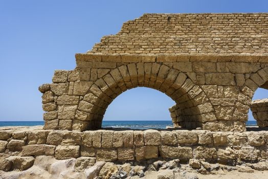 Ancient Roman aqueduct in Ceasarea at the coast of the Mediterra