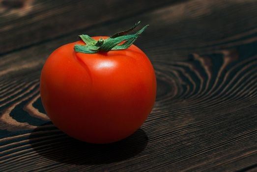 Ripe Red Tomatoes on a Wooden Table