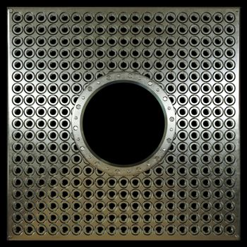 metal plate with holes on isolate black concept photo