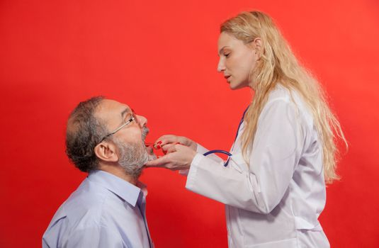 Adult male with female doctor, medical examination of sore throat.
