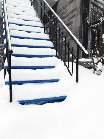 Townhouse staircase covered in snow