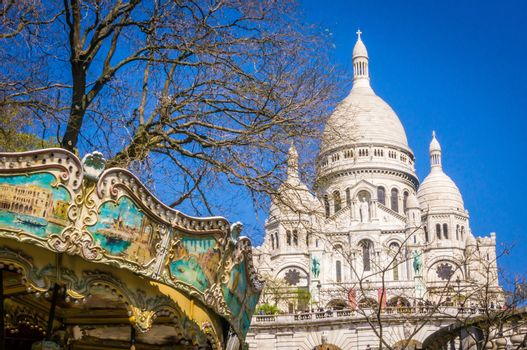 Sacre coeur and merry-go-round in Montmartre