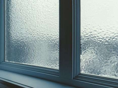 Window frosted after freezing rain