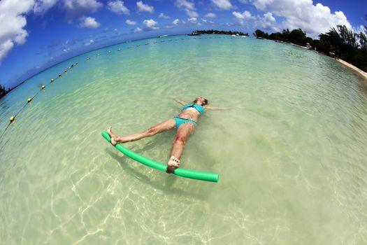 Adult woman enjoying summer in the ocean