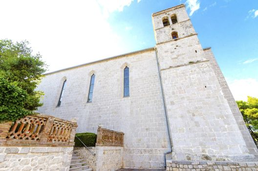 The bell tower of the gothic Church and monastery of St Francis, a Franciscan cathedral of the renaissance period with a quadratic roof, in the Glagolithic square on the island of Krk, in Croatia.