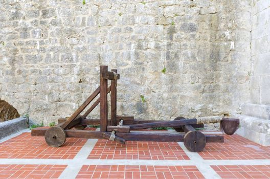 The interior of the Frankopan Castle, at Kamplin square in Krk, Croatia - Frankopanski Kastel, part of the medieval city walls. View of the courtroom, and wooden catapult inside the walls