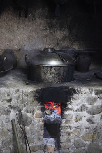 An old stone stove with an old saucepan. China