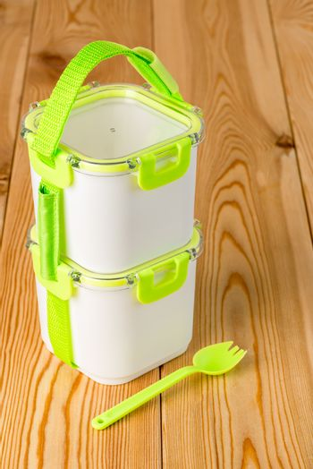 set of empty containers for food preservation with a fork on a w