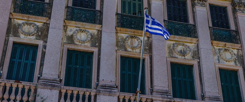 house with balcony with greek flag panorama view
