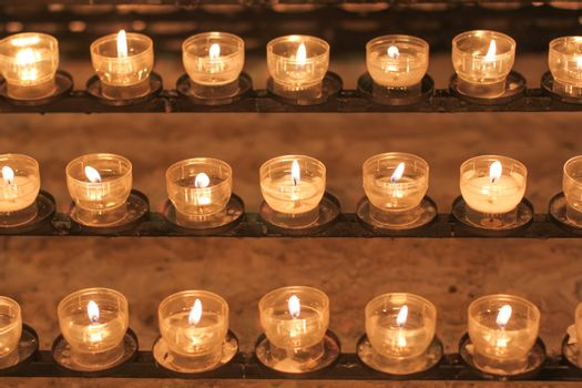 Burning Catholic Church candles, spiritual concept.