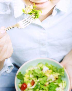 Girl eating fresh organic salad