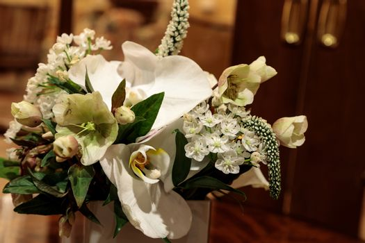 Bouquet of white flowers including roses