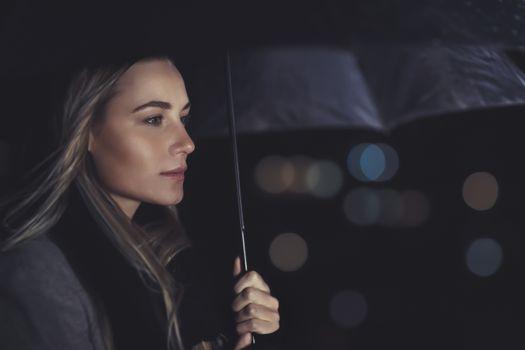 Beautiful woman under the rain
