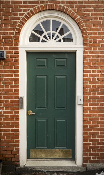 Door of a typical New England residential house with small entrance garden