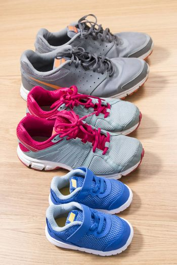 Three pairs of sneakers for the whole family, dad, mom and child.