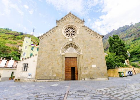Manarola town, Riomaggiore, La Spezia province, Liguria, northern Italy. View of the San Lorenzo church facade, monument landmark. Part of the Cinque Terre National Park and a UNESCO World Heritage Site.