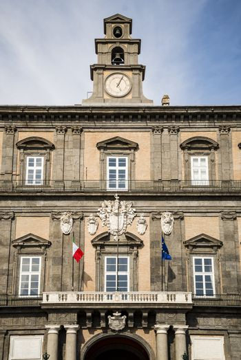 Facade of the historical Royal Palace in Naples, Italy