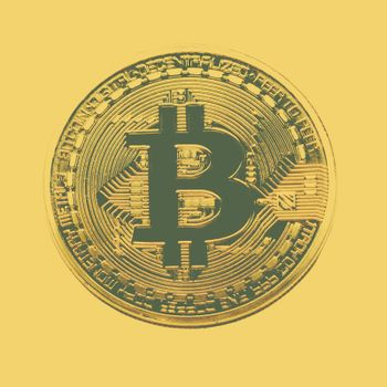 Bitcoin coin photo close-up. Crypto currency, blockchain technology on yellow background