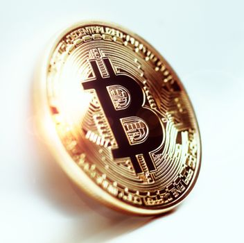 Bitcoin coin photo close-up. Crypto currency, blockchain technology on white background