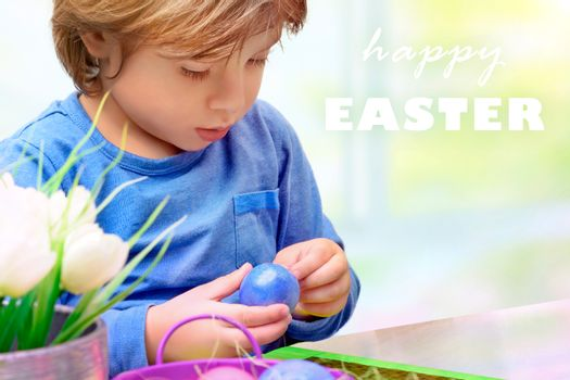 Little boy decorating Easter eggs