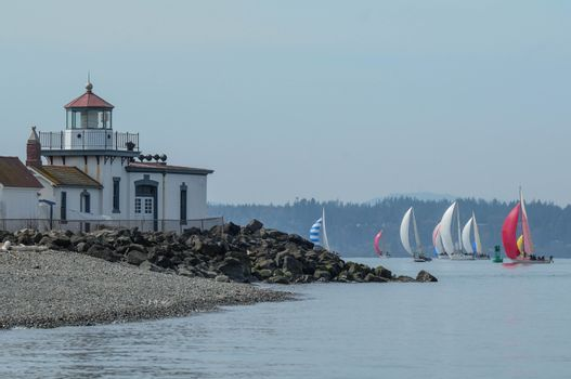 West Point Lighthouse with Sailboat Race in Background