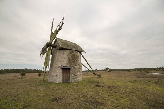 Windmill on Gotland, Sweden with a cloudy sky.