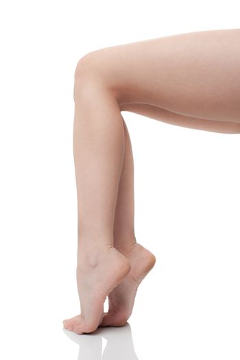 Naked female legs, profile view, on white background