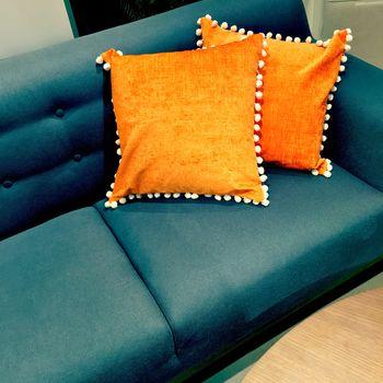 Fancy orange cushions decorating a sofa