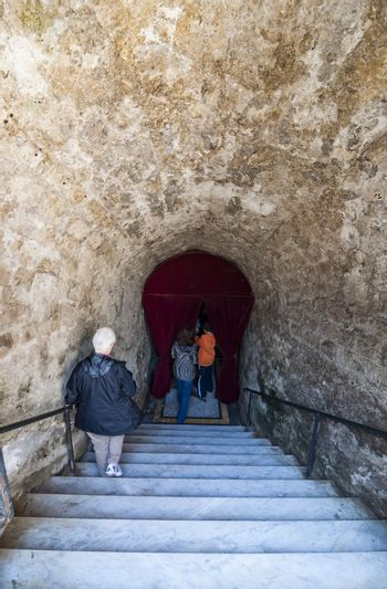 NAPLES, ITALY -MARCH 31, 2012: The entrance of the Catacombs of San Gennaro in the heart of city of Naples, Italy