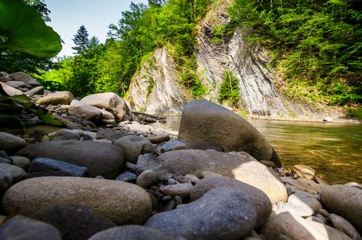 boulders on the shore of the river