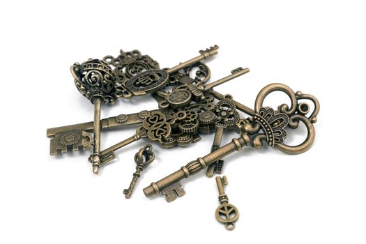 vintage fantasy detailed golden keys isolated on a white background.