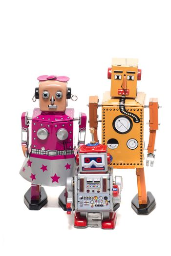 Vintage retro  tin toy robot family concept isolated on a white background.