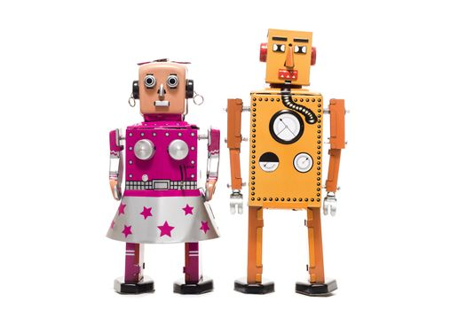 Vintage retro  tin toy robot couple concept isolated on a white background.
